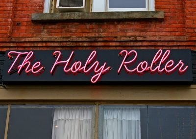 Holy Roller neon sign