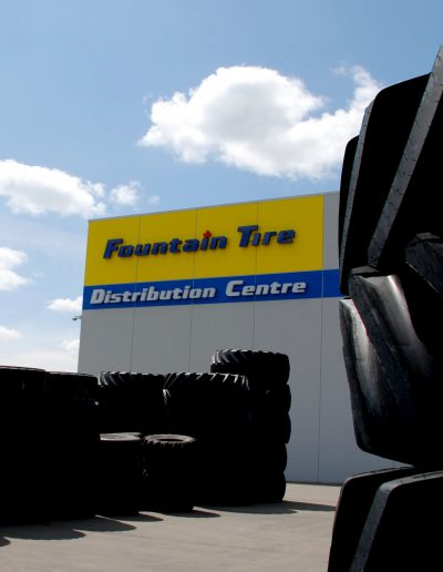 Fountain Tire Distribution Centre sign in Acheson