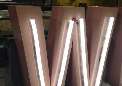 Closeup of Wilfred's W flexibrite sign