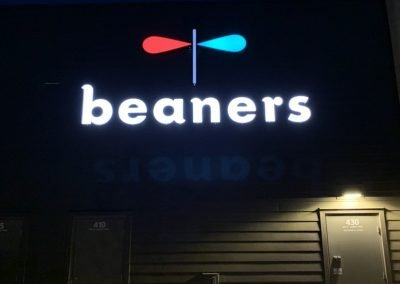 Beaners Night view of rear sign