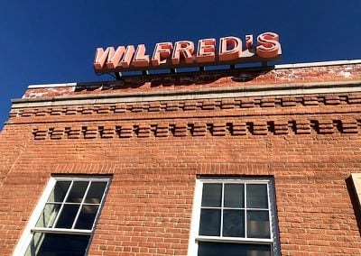 Grade view of roof sign for Wilfred's